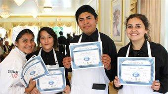 Hospitality Academy graduates holding certificates