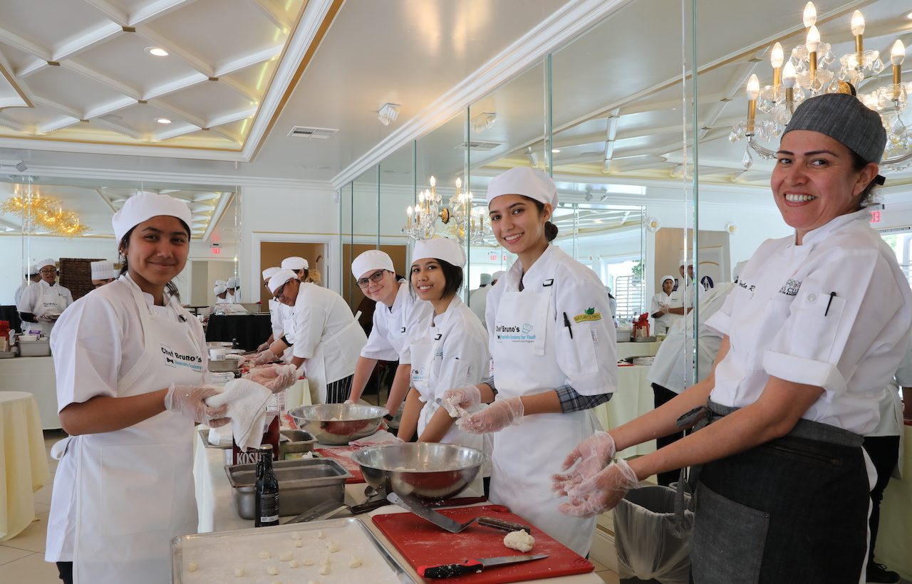Students of the 2019 Hospitality Academy making dough