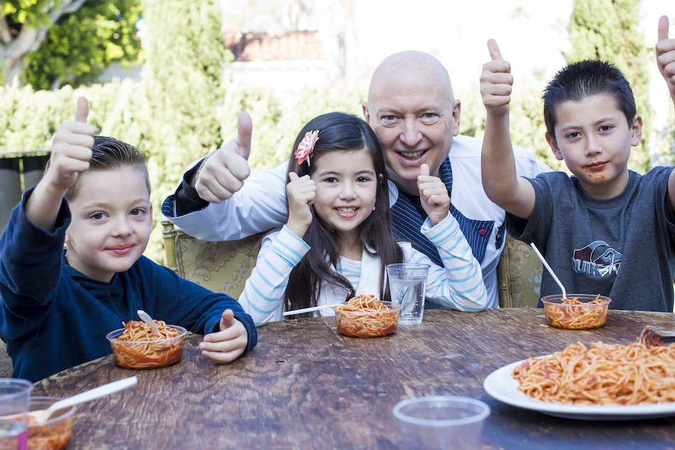 bruno serato three kids giving thumbs up with pasta